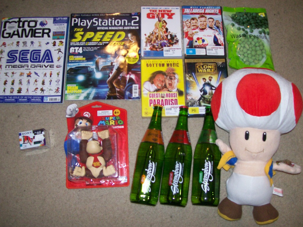 retrogamer magazine, donkey kong figure, giant toad doll etc