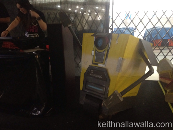 a cardboard model of a claptrap from borderlands 2